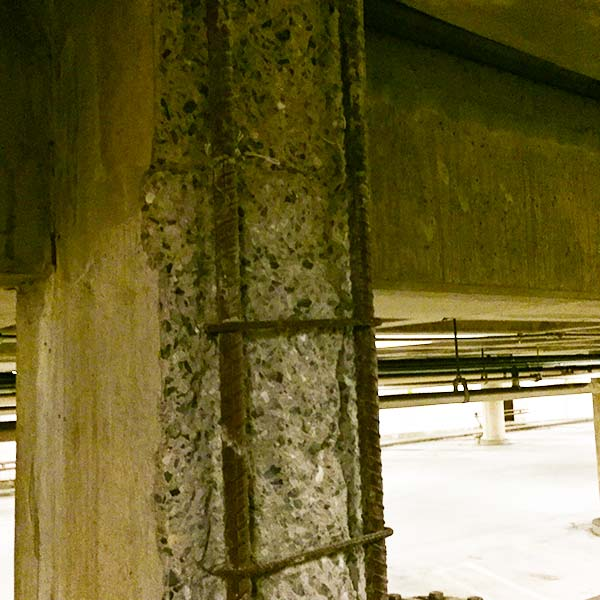 Exposed rebar and broken concrete require repairs in the Main Capitol Parking Garage.