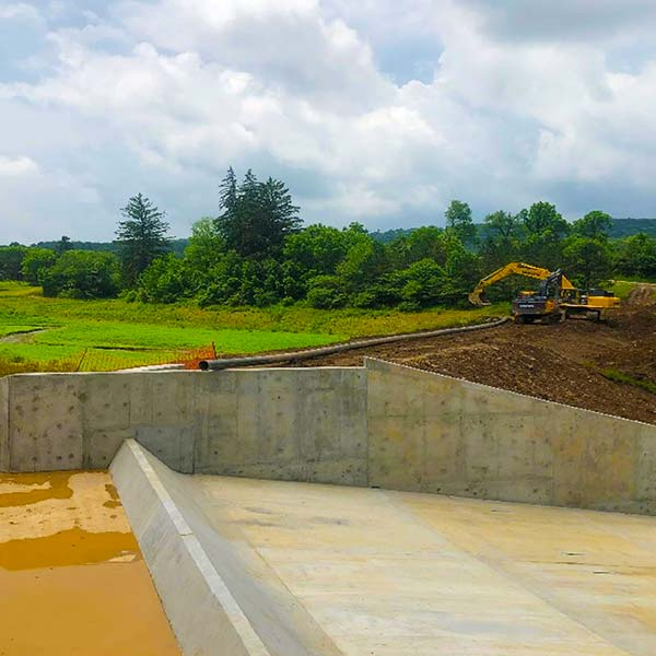 Concrete walls and flooring are used in this dam renovation.