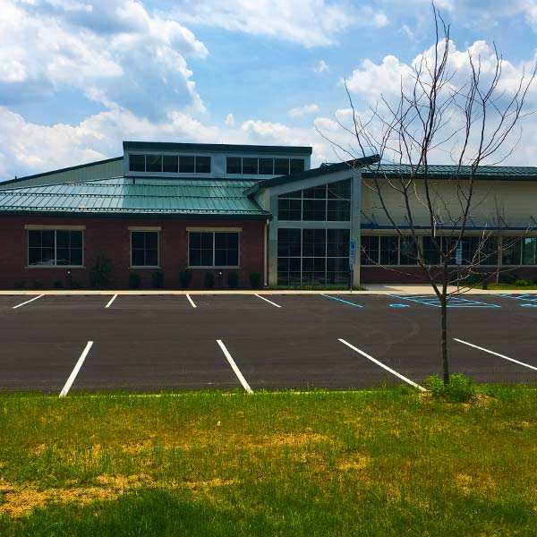 Exterior photo of a new PennDot maintentance facility and its parking lot.